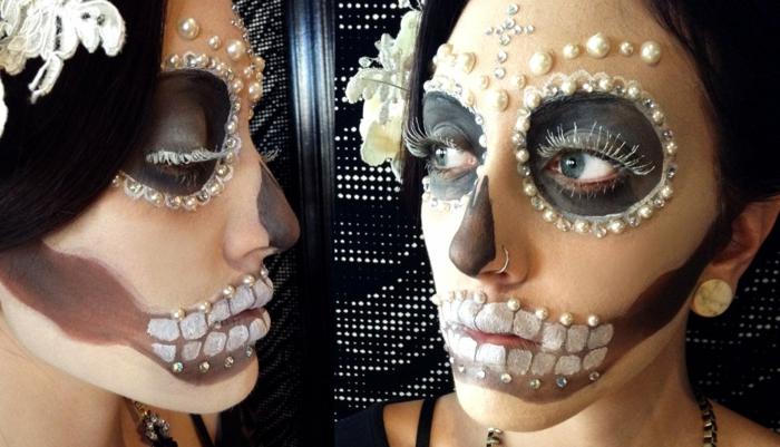 perles et strass pour le visage d'une jeune fille maquillée pour halloween, fleur blanche dans les cheveux