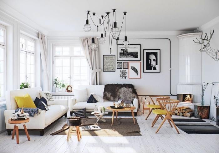 déco cocooning salon scandinave moderne avec un mur de cadres et quelques touches de jaune moutarde qui dynamise l'intérieur
