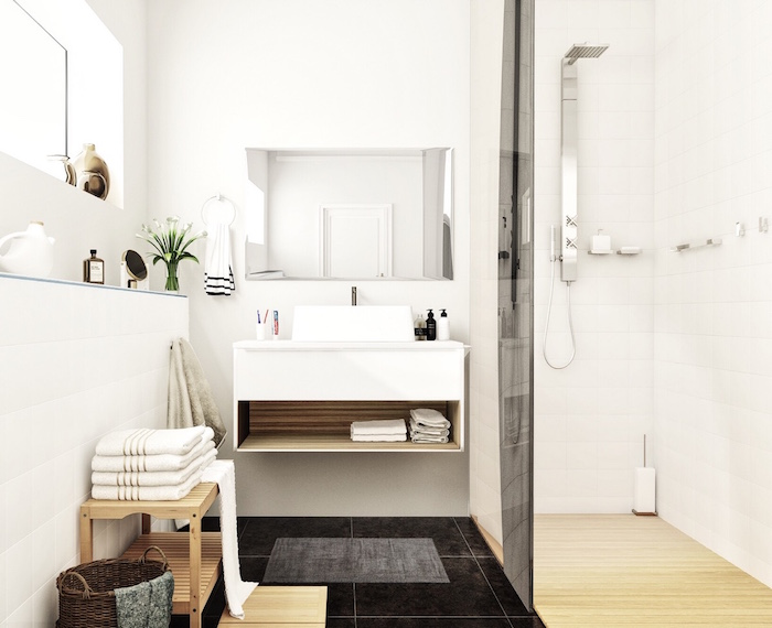 salle de bain type scandinave blanche avec douche italienne à sol en parquet et carrelage noir et vasque design suspendu