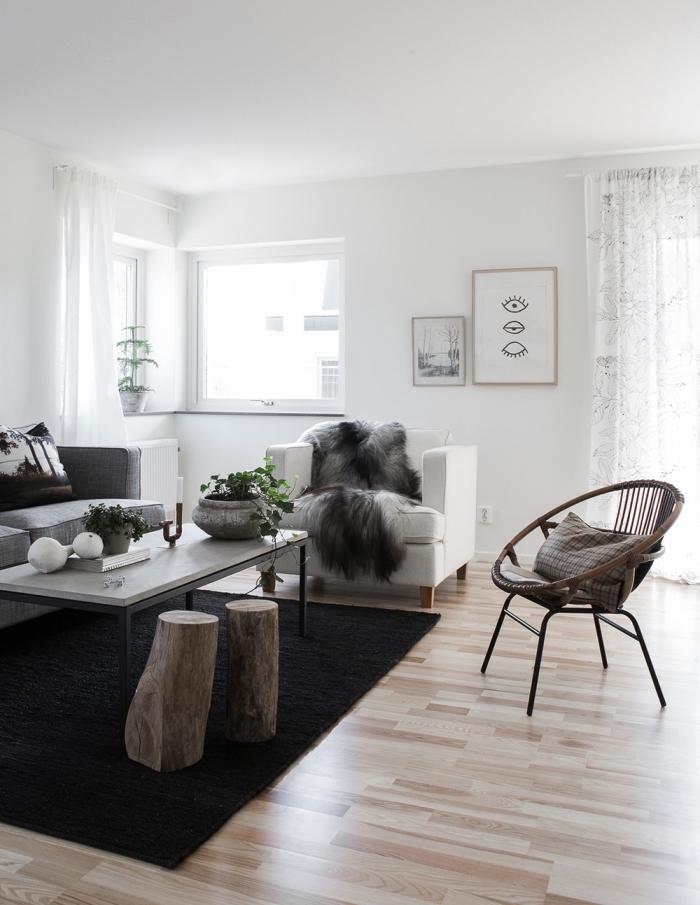 deco salon scandinave en blanc et gris aux accents en bois, ambiance épurée et cosy dans un salon nordique moderne