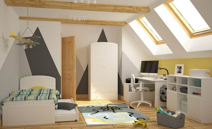 chambre en bois et blanc, tapis gris, bureau et étagère blanche, fenêtres en pente, poutres apparentes, avion suspendu