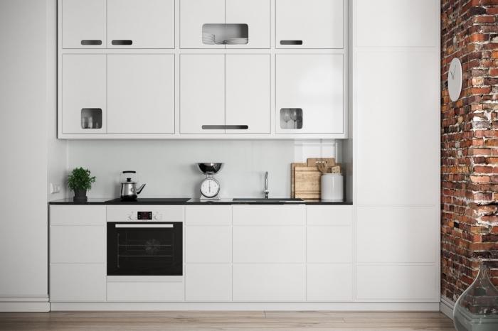 déco de cuisine blanche avec meubles sans poignées et comptoir en noir, exemple revêtement mural de cuisine