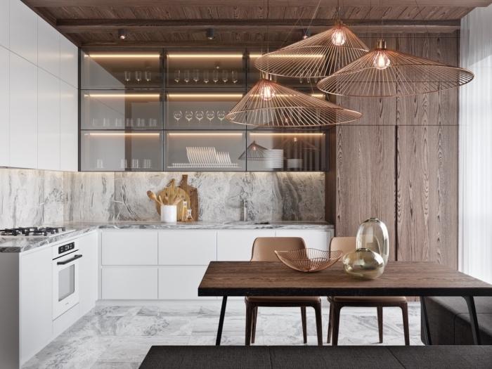 idée agencement cuisine stylée et contemporaine, modèle de cuisine en L avec table à manger, exemple crédence luxe à design marbre