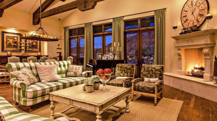 deco maison de campagne cosy, sofa motifs carreaux verts, tapis sisal, peinture murale pêche, tapis naturel, chandelier rustique, cheminée