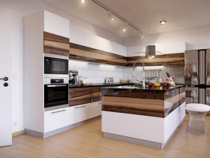 exemple de cuisine élégante avec crédence en carreaux blancs, aménagement cuisine avec îlot, déco cuisine blanc et bois
