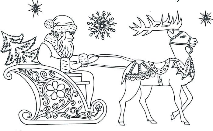 coloriage du père noel sur son traineau tiré par son renne le soir de noel pour la distribution de cadeaux aux enfants sages