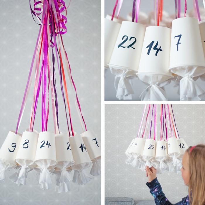 comment fabriquer un calendrier de l avent en gobelets transformés et petits sacs cadeau suspendues sur bandes de ruban colorées