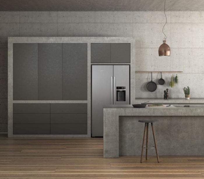 choix revetement mural cuisine moderne, design intérieur style industriel avec murs en béton, modèle cuisine avec îlot
