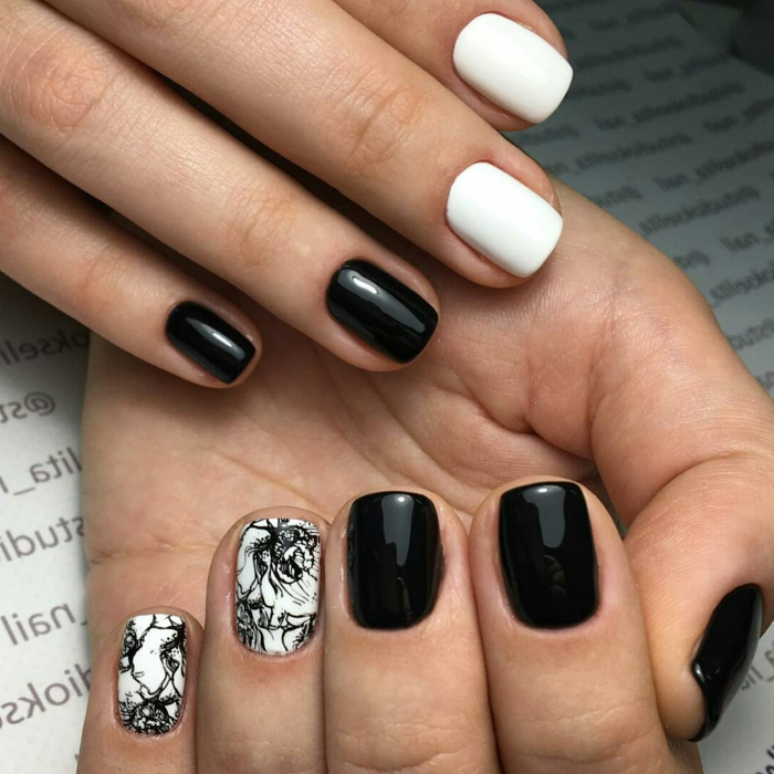 ongles courts en noir et blanc, dessin sur ongle avec outil spécial, déco ongles en deux couleurs