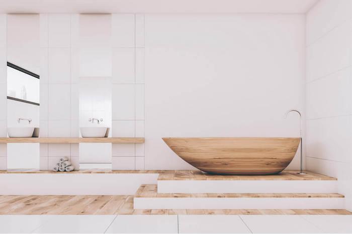modele de salle de bain zen spacieuse luxe avec marche et baignoire ilot en bois ovale et deco minimaliste blanche type scandinave