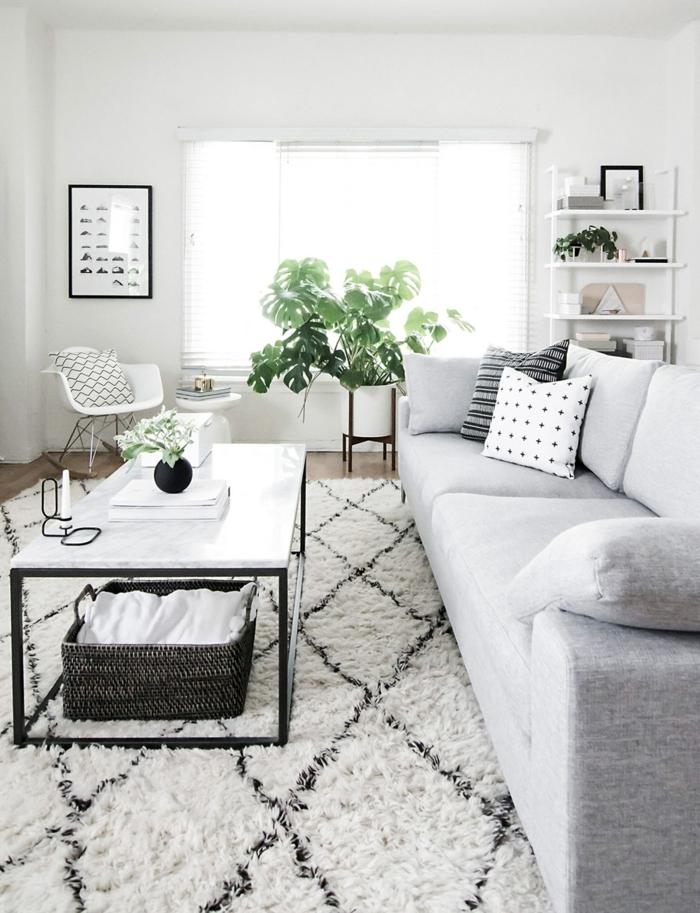 design de salle de séjour scandinave, table basse rectangulaire, tapis à diamants, sofa gris clair, chaise scandinave
