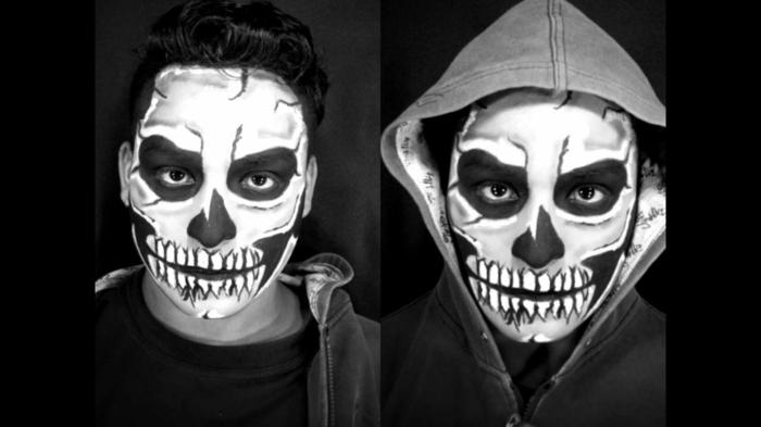 déguisement homme pour halloween, orbites noires autour des yeux, dents terrifiantes, capuchon gris