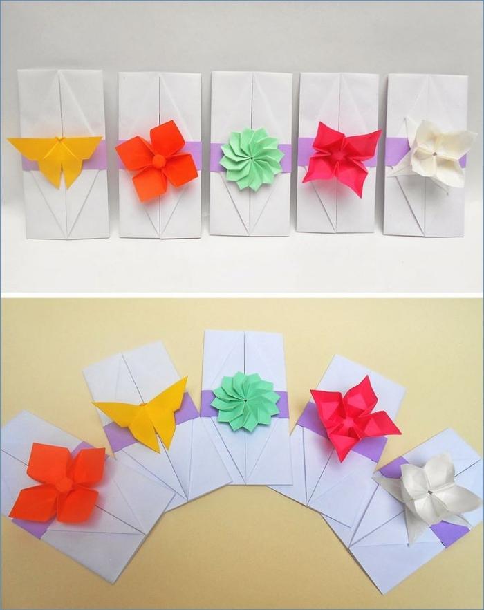 jolie pochette origami pour accueillir un faire-part ou une invitation de mariage, décorée avec une fleur en origami en papier de couleur