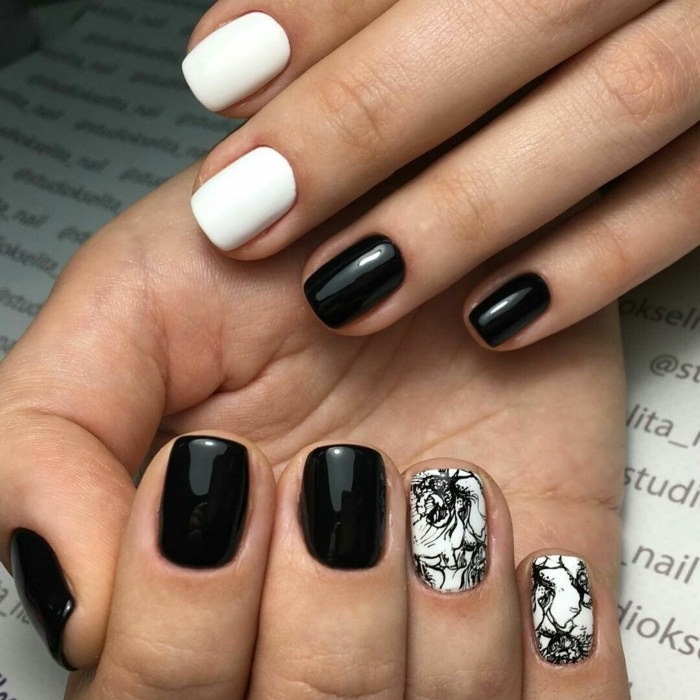 manucure en noir et blanc, motifs artistiques noirs, déco des ongles courts carrés