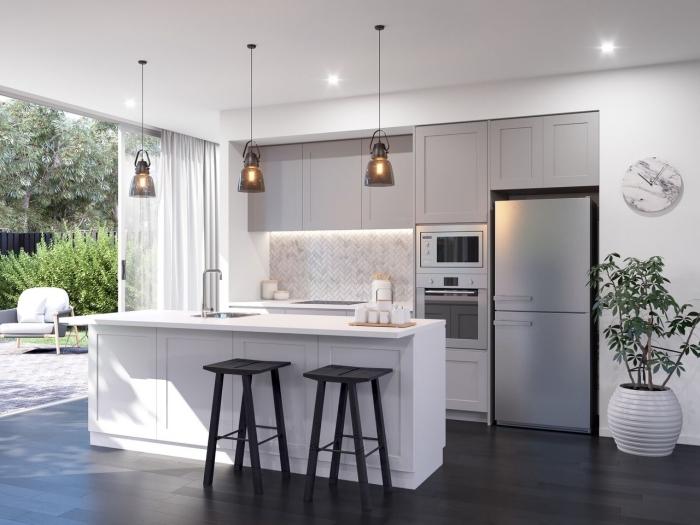 exemple comment aménager une cuisine en longueur avec îlot, modèle de cuisine en blanc et gris avec accents en noir
