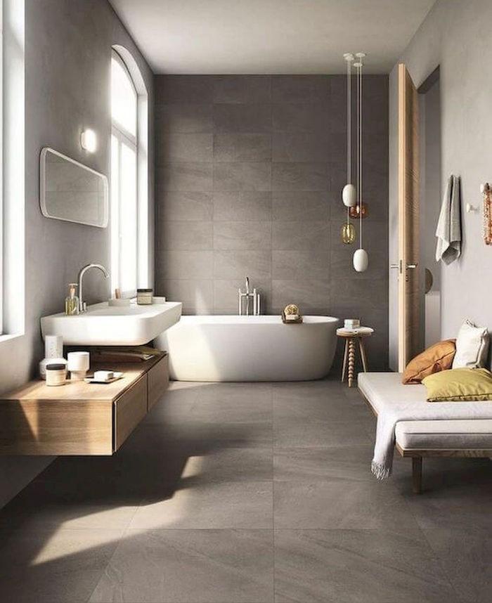 photo grande salle de bain spacieuse avec sol et mur en béton ciré gris banc et grand lavabo scandinave