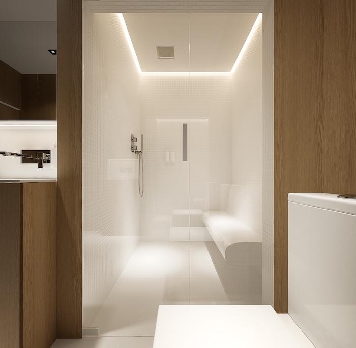 aménagement salle de bain avec espace sauna avec banc et douche italienne design en bois et murs blancs brillants