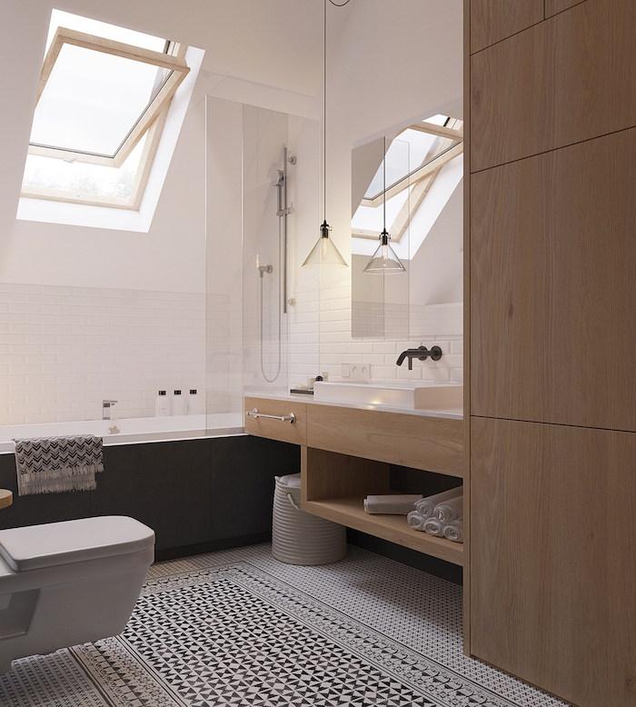 salle de bain mansardée sous toit avec meuble design en bois style scandinave et murs blancs et sol en carrelage mosaique bleue