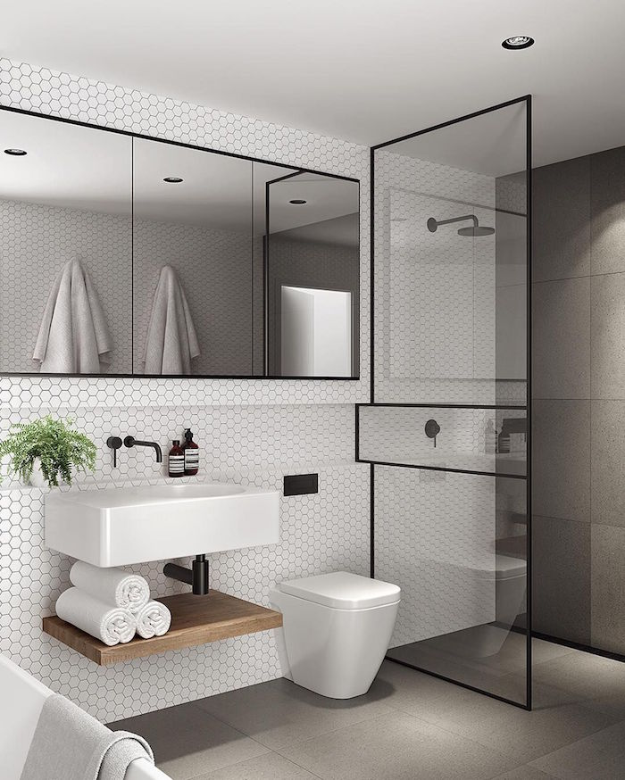 amenagement salle de bain petit espace design avec douche italienne avec carrelage mural large porte vitrée et vasque lavabo moderne type scandinave