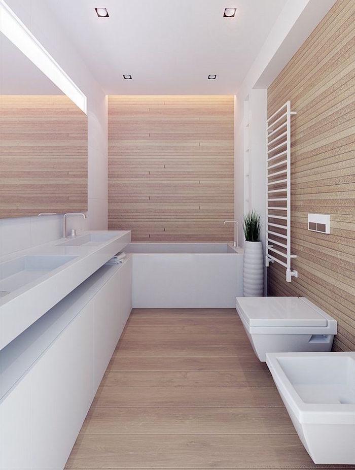 salle de bain style sauna scandinave avec bois sur sol et murs et meubles design minimalistes blancs brillants