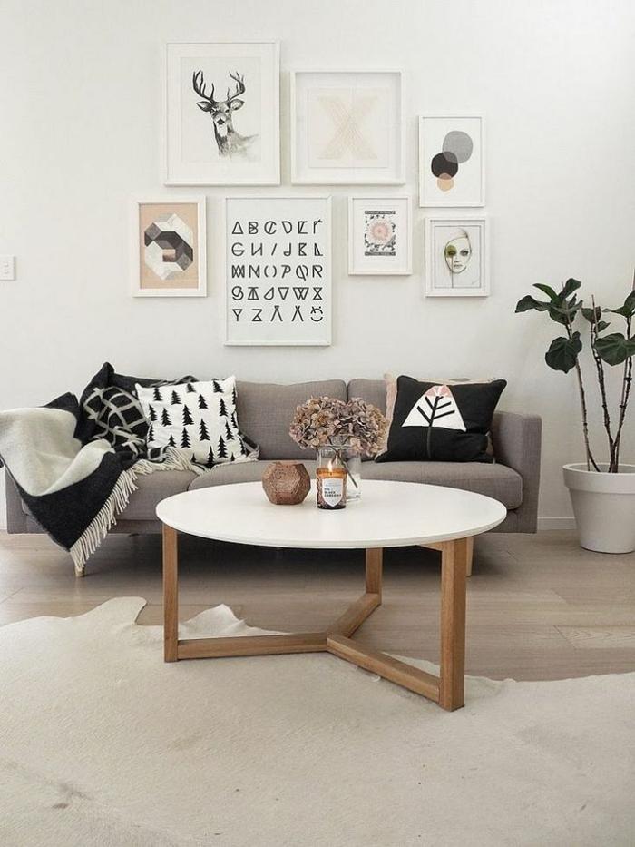 table basse scandinave, pieds en bois, déco peinture style scandinave, grand pot de fleur, plaids et coussins