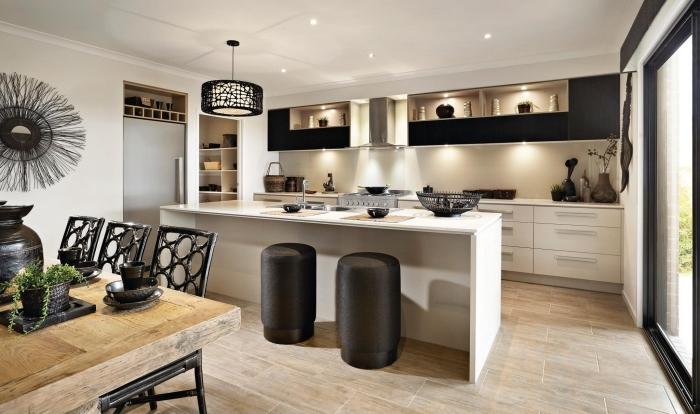 exemple de cuisine aménagée pas cher, modèle de cuisine ouverte avec îlot central aménagée en blanc et noir
