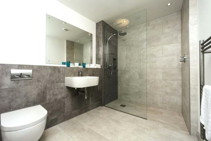 salle de bains en gris et blanc, vasque blanche, douche à l'italienne, vasque suspendue, carreaux gris clair au sol et gris anthracite au mur