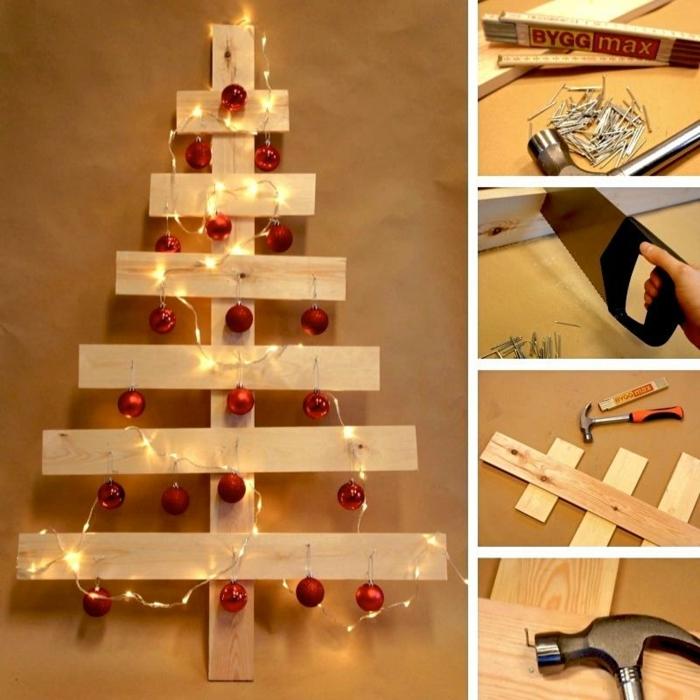 sapin de noel décoré de guirlande de boules de noel rouges, clous, marteau, scie et planches de palette
