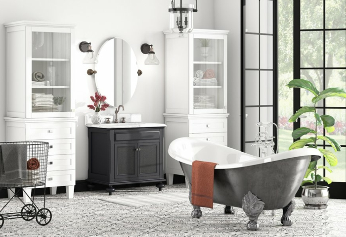 grande baignoire en fonte, panier chariot, porte atelier, meuble colonne, miroir ovale, plante verte