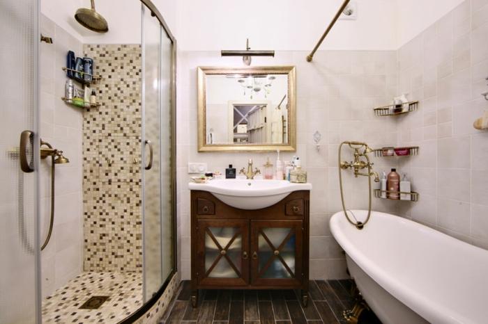 baignoire ovale, cabine de douche, parois en verre, grande tête de douche, miroir carré encadré, meuble sous vasque en bois, sol en planches