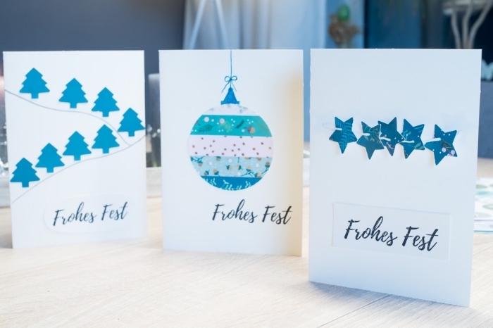modèles de carte de voeux noel en blanc et bleu, décoration papier scprabooking avec figurines noel en bleu et blanc