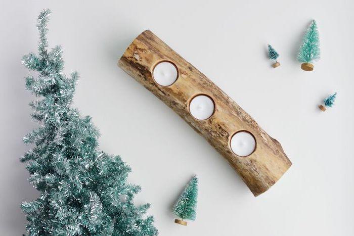 décoration de noel à fabriquer en bois, tronc de bois avec des bougies dans trous, mini sapins de noel décoratifs