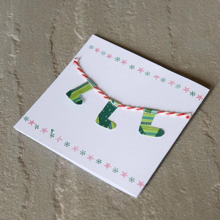 décoration carte de Noel facile, exemple de DIY carte en papier blanc avec dessins étoiles et flocons de neige en bordure