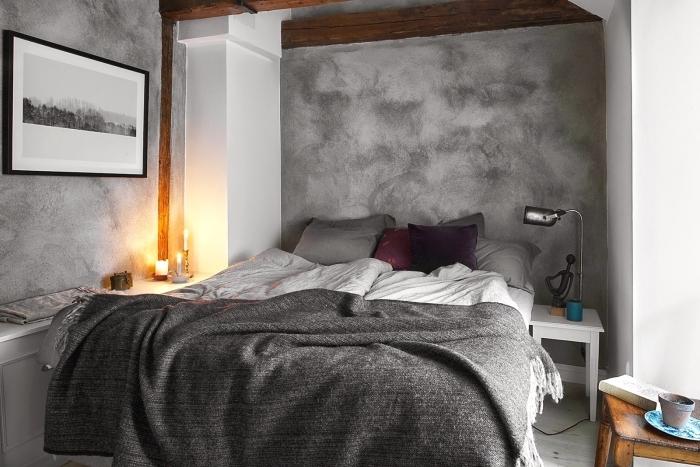 ambiance scandinave dans une chambre peinte en gris quartz, déco cocooning avec meubles en bois, plaid gris anthracite avec franges