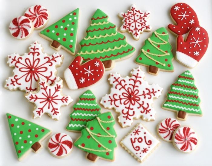recette biscuit noel en formes sapins, comment décorer des cookies noel en formes de flocons de neige blanc et rouge