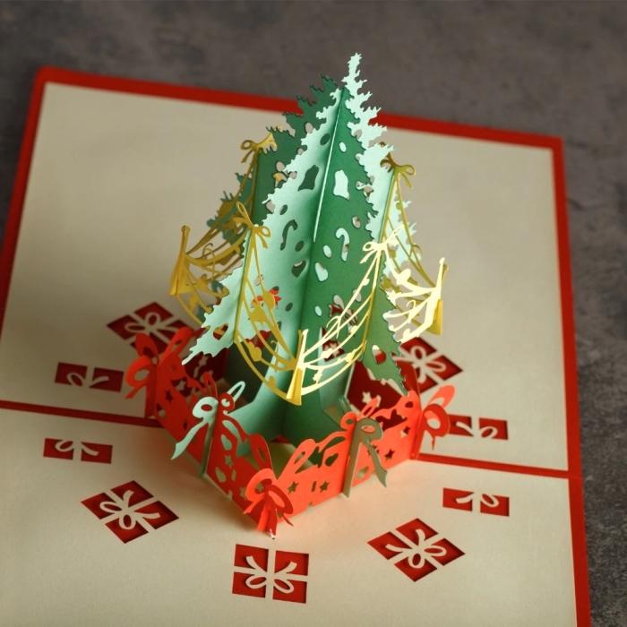 exemple de carte pop up noel avec sapin en papier coloré, modele de carte de voeux à faire soi même avec technique origami