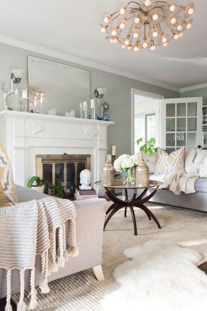 idée peinture grise verdâtre dans un salon au plafond blanc, déco relaxante avec statuette bouddha et coussins