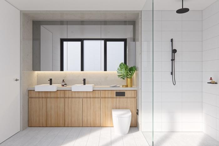 meuble salle de bain double vasque en blanc et bois, agencement salle de bain moderne, cabine de douche en carreaux blancs avec finition noir mate