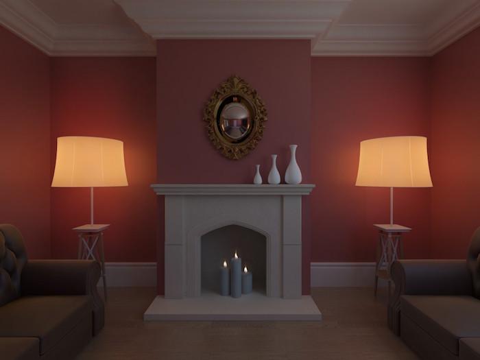 fausse cheminée décorative minimaliste gris béton avec trio de bougies grises dans salon avec murs bordeaux sur moquette et duo de lampes symétriques