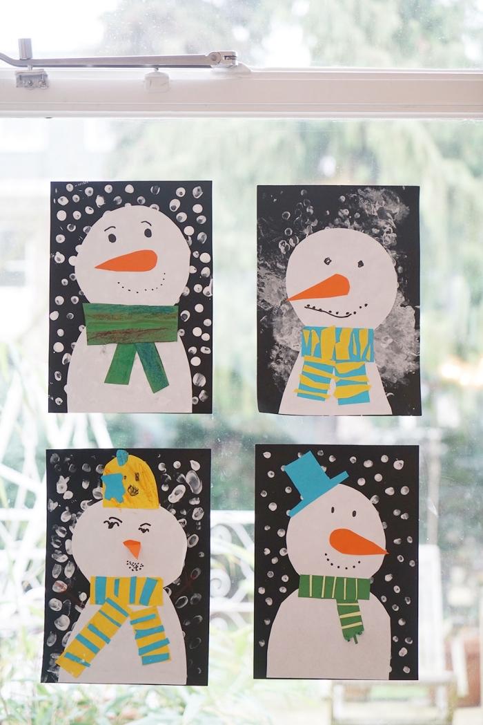 des bonhommes de neige en collage sur un fond noir tâché de blanc pour une déco fenetre noel facile à réaliser, bricolage de noëm maternelle