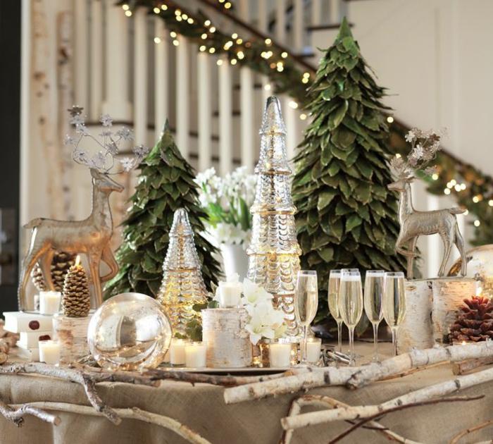 deco noel lumineuse verres  champagne remplis sapins d coratifs boule de verre branche de bouleau statuettes de cerfs