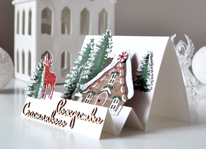 exemple de carte de noel a fabriquer, modèle carte pop up DIY à design paysage de noel avec maison et sapins découpés de papier