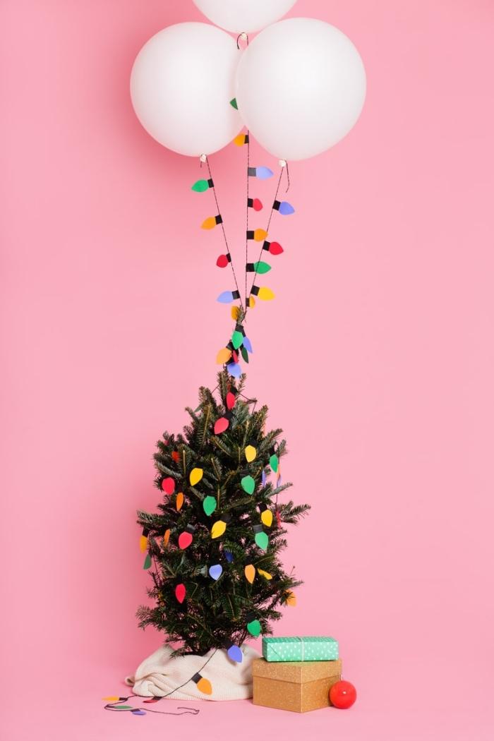 decoration de noel fait main pour réaliser une guirlande de ballons et de petites lampes colorées en papier, idée de décoration de sapin originale et facile à réaliser soi-même