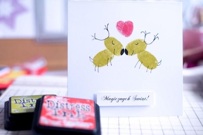 comment décorer une carte vierge pour Noel, exemple de bricolage enfants avec papier et empreintes couple cerfs de Noel