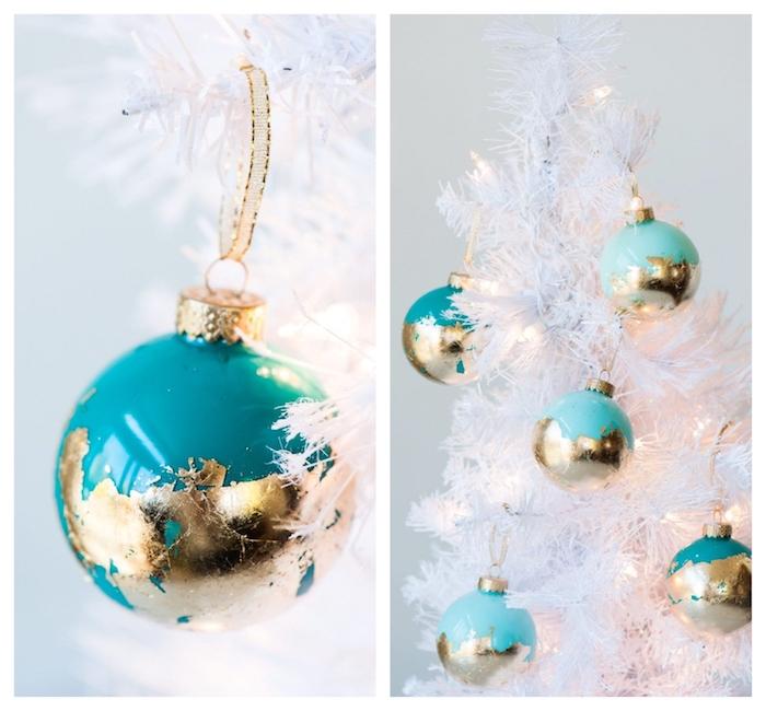 deco sapin de noel blanc décoré de boules de noel transparentes décorées de peinture bleue et feuille d or à l extérieur