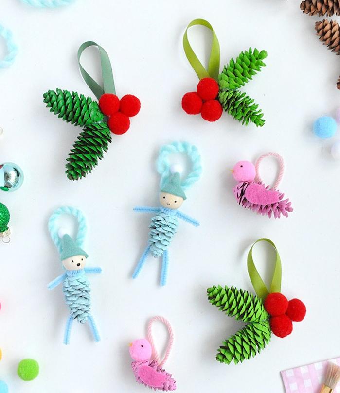 petits lutins de noel a faire soi meme en pommes de pin repeintes et des têtes en perles de bois, ornements sapin de noel, feutrine et pompons colorés