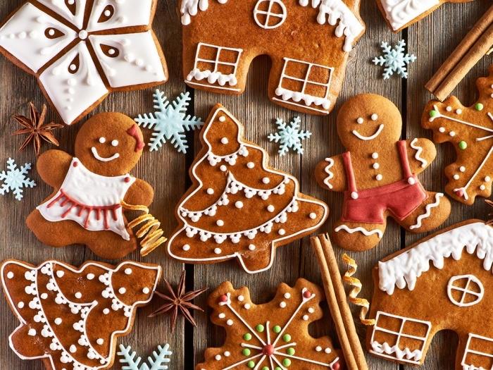 cookies au gingembre et à la cannelle en formes bonhommes de neige, découpez des biscuits de noel avec emportes pièces