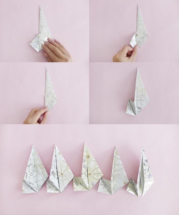 fabriquer une étoile de noël en pliage origami facile en papier à motifs métallisés pour faire une guirlande festive à suspendre au mur