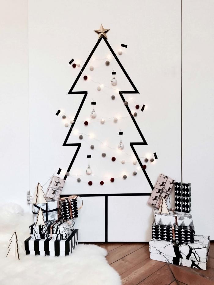 un sapin minimaliste noir et blanc en masking tape qui s'inscrit parfaitement dans l'ambiance nordique du salon