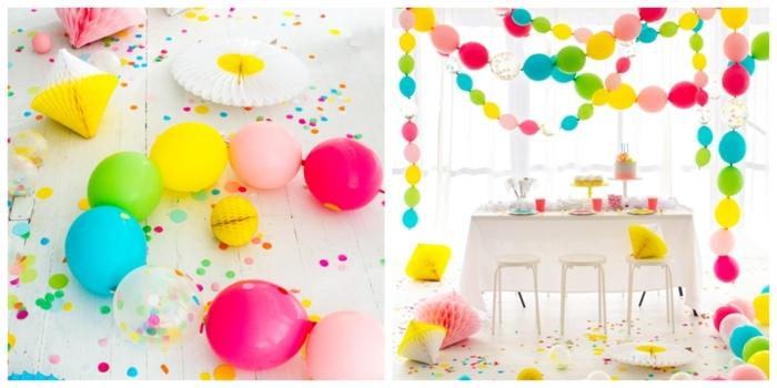 pièce blanche avec guirlandes de ballons flottants aux couleurs vives, paillettes, table et tabouret blancs